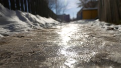 Footpath in the city of ice and snow is slippery winter frozen Stock Footage