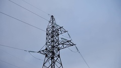 Electrical tower with cables against gray electricity background Stock Footage