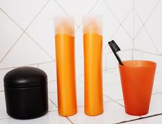 Usual stuff in bathroom, shampoo, accessories, black stylish toothbrush, casual Stock Photos