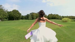 Back view of running bride. Arkistovideo