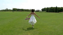 Bride running and jumping. Arkistovideo