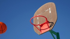 Old basketball hoop, sport street basketball throw the ball in the basket Stock Footage