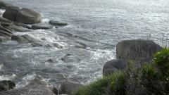 Ocean surf on the rocky beach Stock Footage
