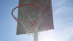 Old basketball hoop against a blue sport street Stock Footage