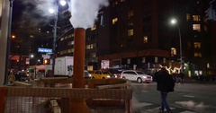 Manhattan Night City Scene Intersection with Exhaust Pipe Stock Footage