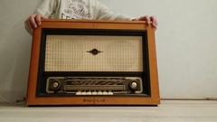 Young man opens and closes radio gramophone. Arkistovideo