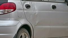 Crumpled car door accident insurance case Stock Footage