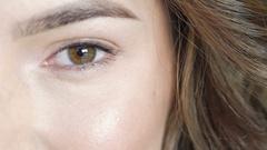 Close up female eye blinking. Slowly Stock Footage