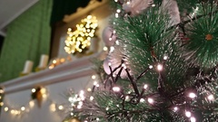 Christmas interior tree and New Year toys blinking lights and room fireplace Stock Footage