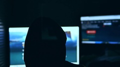 Hacker man, trying to breach security of a computer system search internet Stock Footage