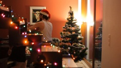 Stripped of Santa Claus dancing with a girl near the Christmas tree. Stock Footage
