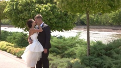 Bride and groom kissing outdoors. Stock Footage