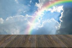Blue sky cloud with Wood terrace and rainbow Kuvituskuvat