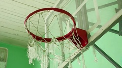 Basketball hoop and a billboard in the school sport gym Stock Footage