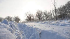 Road trail in the snow sunlight winter landscape beautiful golf snowing sun Stock Footage