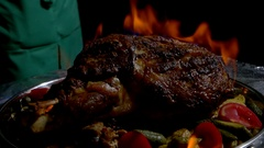Flambe meat with vegetables. Stock Footage