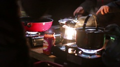 Preparing a meal on a camping gas stove Stock Footage