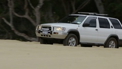 4x4 Vehicle driving up a long and steep sand dune Stock Footage