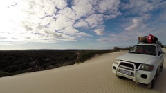 4x4 Vehicle standing atop a sand dune in beautiful landscape Stock Footage