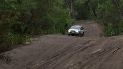 4x4 Vehicle driving along challenging sandy track Stock Footage
