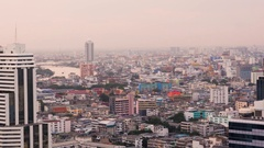 Pink light of early dawn enchants the oriental city of Bangkok Stock Footage