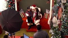 Christmas shopping mall Santa Claus listens to childrens wish list Stock Footage