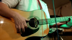 Acoustic guitar. Musician plays rock style music. Six strings Stock Footage