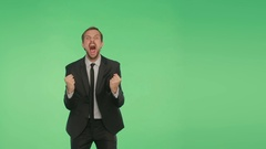 Body language. a man in a business suit on a green background, chromakey, Stock Footage