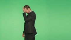 Businessman on a green background, gesture chagrin. body language. chromakey, Stock Footage