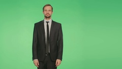 Body language. a man in a business suit on a green background. chromakey, Stock Footage
