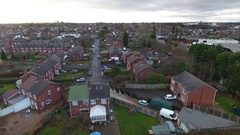 Low aerial view of a UK street. Stock Footage