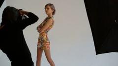 Photographer shooting model at studio Stock Footage