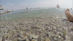 Coastal, beach. Summer season . Vacationers people in the sea. Stock Footage