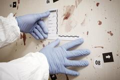 Police technician preparing documentation of evidences on crime scene Stock Photos