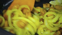 Mushrooms and onion fried with oil in a frying pan Stock Footage