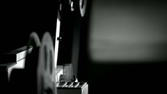 The movement of 16 mm film in film projector, close up. Stock Footage