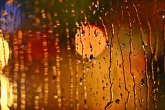 Photos night city made through glass. Street. Rain. Piirros