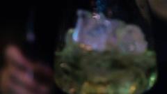 Alcohol liquid pooring into big wineglass Stock Footage