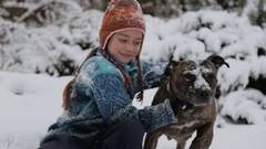 A boy plays with a dog in winter. With friend and favorite pet on nature. Stock Footage