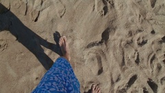 Man walk on sand beach, waves gentle wash his feet. Summer. First person view Stock Footage