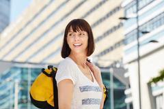 Smiling older traveler carrying duffel bag in city Stock Photos