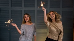 Two happy girls with a sparkler in their hands Stock Footage