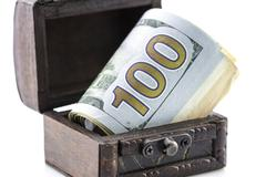 Treasure chest,the box of money,coins and dollars Kuvituskuvat