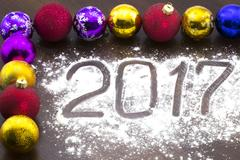 New Year's multi-colored Christmas balls on table. Stock Photos