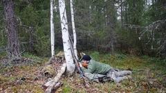 Hunter man shoots from a gun Arkistovideo