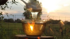Play of light in stream of honey Stock Footage