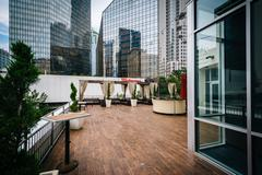 Outdoor seating area and modern buildings in Uptown Charlotte, North Carolina Stock Photos