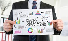 Data analysis concept shown by a businessman Stock Photos