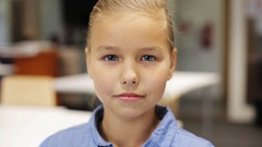Happy smiling beautiful preteen girl at school Stock Footage