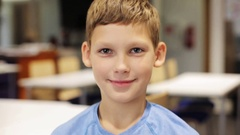 Happy smiling preteen boy at school Stock Footage
